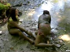 Two Hot Bitches Have A Mud Fight