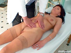 Doctor plays with old pussy