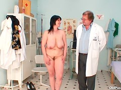 Doctor gives her gyno exam