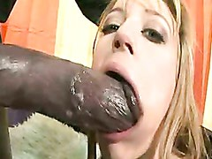 Tattooed honey Holly Wellin stuffs her mouth with a thick shaft and enjoys it