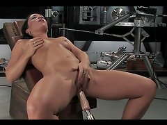Vibrator and Powered Cock Machine Take Brunette to Paradise