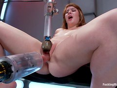 Redhead bitch gets fucked by machine