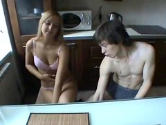 Amateuer Sex With A Horny Couple In The Kitchen