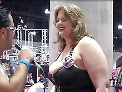 Big breasted women in bikinis and leather pole dancing