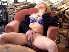 Horny mature lady in fishnet is roaring from masturbation