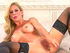 Adorable blonde prostitute Cherie Deville wears stockings and no panties. She fingers her sweet clit