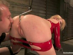 Slave In Red Latex Suit