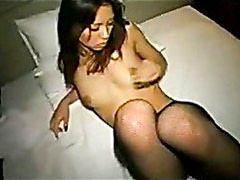 Cute asian girl in fishnet pantyhose gets