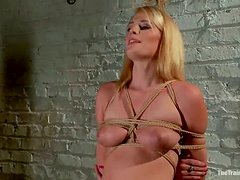 Pretty Allie James gets her pussy stuffed in bondage video