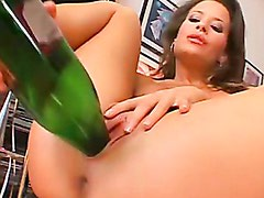 Lora Craft masturbates her cunt and tight ass with a bottle of wine