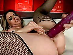 Hot babe Chloe Delaure stuffs a massive dildo toy in her pink hole