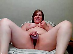 Young chubby girl masturbating on bed