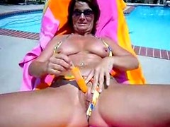 Hot Milf Cooling Down By The Pool