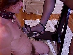 Redhead latex mistress hitting her slave