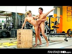 Sexy trainer rides cock in the gym