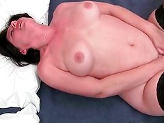 MILF with big tits plays with vibrator