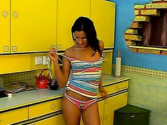 Monica plays with herself in the kitchen