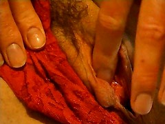 Andrea fucks herself with her fingers