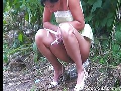 The pissing Russian girl in bushes