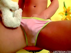 Solo pigtailed teen rubs pussy