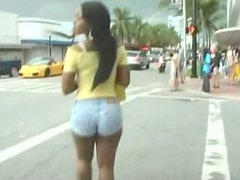 Latina walking in booty shorts