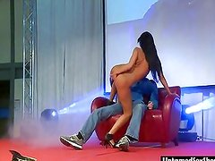 Sexy stripper gives a porn show on stage