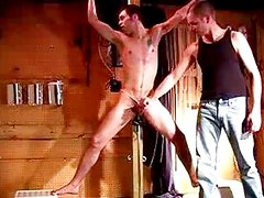 Slave is tied up and his master is playing wi