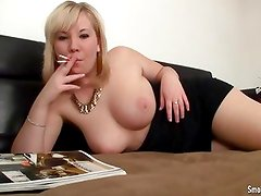 Busty amateur smokes two