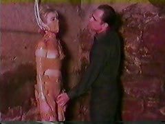 Bound woman humiliated by her master