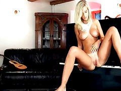 Busty blond toying snatch on the piano