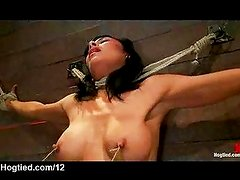 Busty zippered babe rides Sybian in the air