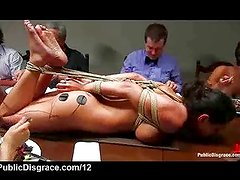 Hogtied on table at dinner party
