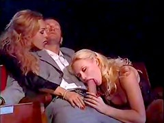 Theater threesome with cumshot