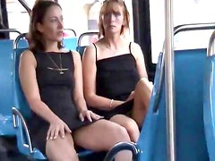 Fun gals kiss on bus