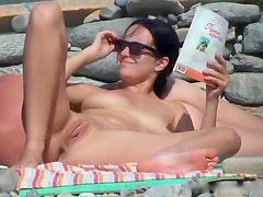 Hot tanning babes on beach