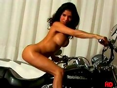 Alexis Amore is a naked motorbike fan