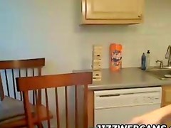 Cam girl teases in Kitchen