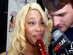 Destiny Dream sticks a candy dick in her pussy