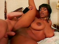 Enormous black tits and a slut at work