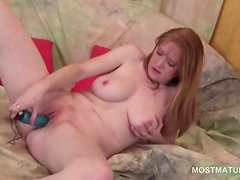 Adult woman gets pleasure from a vibrator
