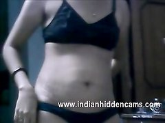 Indian bhabhi surrounding her hubby taking her shirt off to demonstrate her awesome hot melons