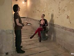 Blonde in Latex Outfit Maitresse Madeline Pegging and Spanking a Guy