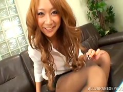 Horny office manager gives a nice footjob to her man
