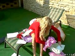 Hot and sensual blonde bombshell enjoys in sitting in the