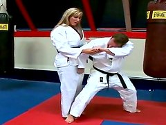 Pretty hot and sexy blonde lady Sarah Jackson doing some exercises at karate