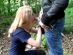 Tasty looking blondie gives a blowjob to her BF in the forest