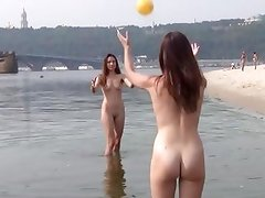 Naughty nudists play with each other in sand