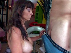 Mature long haired brunette whore with gigantic fake tits and