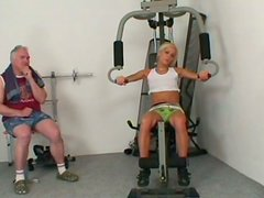 Horny coach jerks off while awesome sporty girlie Adela B trains in the gym