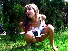 Sexy teen is pissing in the forest